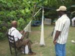 Captain Legree teaches cast net making.