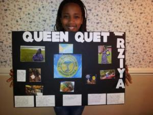 Rziya stands proudly with her report on Queen Quet, Chieftess of the Gullah/Geechee Nation (www.QueenQuet.com).  The report is now on the wall in the hallway at her school in North Carolina for all to learn about the Gullah/Geechee Nation's first head-of-state.