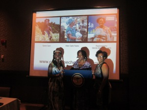 Queen Quet, Chieftess, Elder Carlie Towne, Minister of Information, and Representative Glenda Simmons-Jenkins of the Gullah/Geechee Nation stand beneath themselves at their training session that they led for the US EPA.