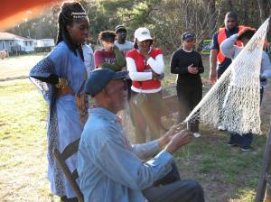 The Gullah/Geechee Ga'dun is the outdoor educational engagement area of the Gullah/Geechee Sea Island Coalition (www.gullahgeechee.net) where numerous Gullah/Geechee traditional crafts and language and music workshops are conducted annually.  Captain Legree is the cast net instructor.