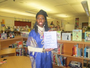 Queen Quet, Chieftess of the Gullah/Geechee Nation stands proudly with her book that was created for her by the 1st graders of St. Helena Elementary.  www.QueenQuet.com