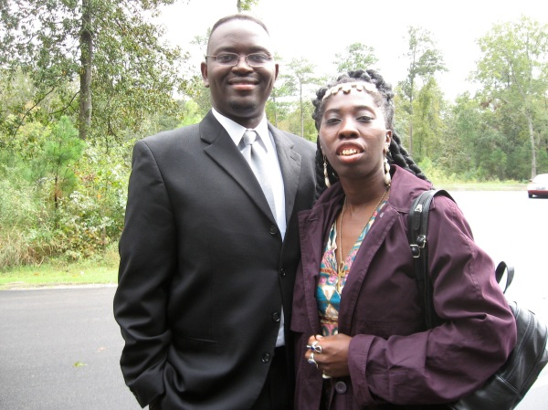 South Carolina Senator Clementa Pinckney stands with Queen Quet whom he had honored through a state resolution.  The two united on many issues to uplift the Gullah/Geechee community in SC.  He will truly be missed.
