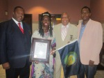"""Chatham County Councilmen Shabazz and Holmes stand proudly with Queen Quet, Chieftess of the Gullah/Geechee Nation (www.QueenQuet.com) and Dr. Amir Jamal Toure after presenting them with the first Georgia """"Gullah/Geechee Nation Appreciation Week"""" proclamation."""
