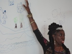"""Queen Quet, Chieftess of the Gullah/Geechee Nation (www.QueenQuet.com) explains what the pain of relocation would be like for the Gullah/Geechee family via an artistic exercise during an engagement entitled """"Transforming Communities at the Water's Edge."""""""