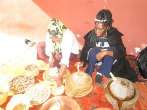 Queen Quet, Chieftess of the Gullah/Geechee Nation and Sister Aminah preparing Argan oil.