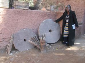 Queen Quet, Chieftess of the Gullah/Geechee Nation with Berber flour and couscous grinding stones.