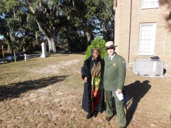 "Queen Quet, Chieftess of the Gullah/Geechee Nation and NPS Director Jonathan Jarvis at Brick Baptist Church on historic St. Helena Island, SC in the Gullah/Geechee Nation. Brick Baptist Church is one of the sites of the ""Reconstruction National Monument."""